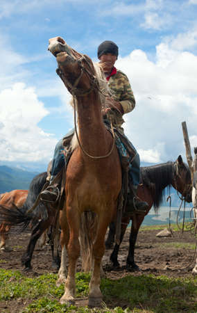 Mongolian herdsman on horseback photo