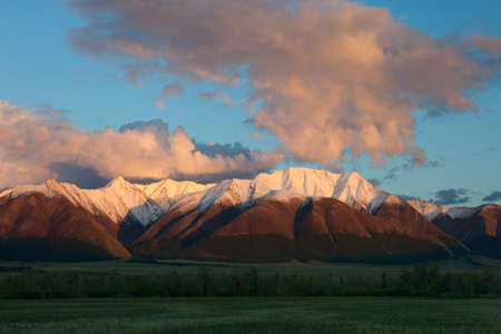 Red Mountain at sunset. Whiten the snow-capped peaks photo