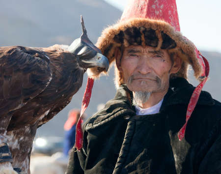 nomadism: Hunting with eagles in the Mongolian Altai. Traditionally Kazakh fun. The Golden Eagle Festival