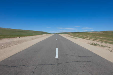 road through the Mongolian steppes photo