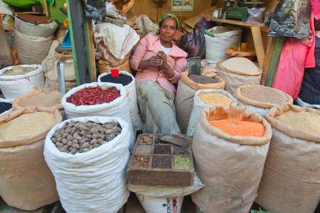 ababa: ETHIOPIA ADDIS ABABA,DECEMDER 27,2013.Seller of spices. Merkato market in Ethiopia,Addis Ababa, December 27,2013