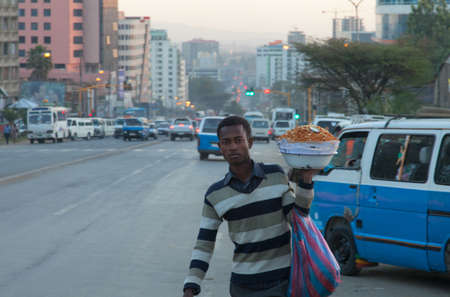 addis: ETHIOPIA ADDIS ABABA,DECEMBER 05,2013. People on the street in Addis Ababa Decemder 05,2013.