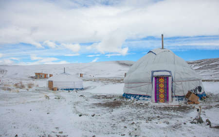 ger: Asian yurt in the winter landscape in the mountains Stock Photo