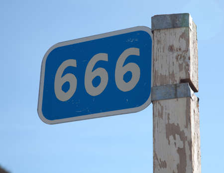 kilometer: kilometer pole with a sign 666