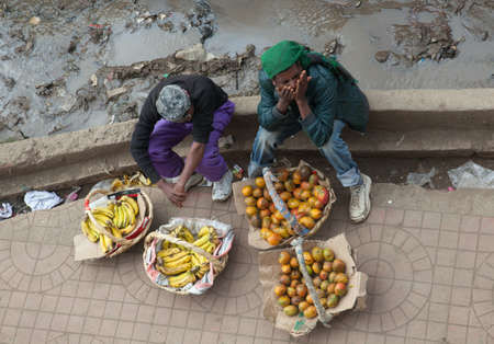 ababa: ADDIS ABABA, ETHIOPIA - JANUARY 29, 2014: Selling fruits on the sidewalk in the Ethiopian capital Editorial