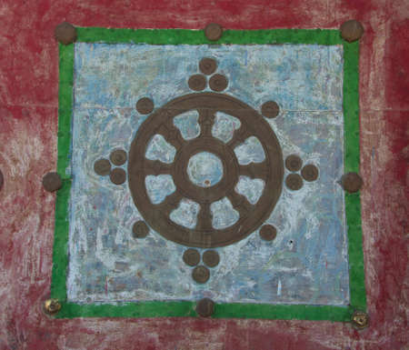 samsara: Mandala graffiti on the wall of a Buddhist monastery in Central Asia Stock Photo
