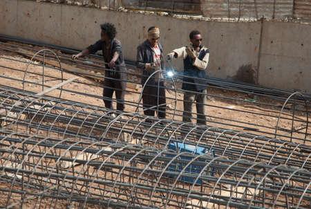 somali: ADDIS ABABA, Ethiopia - FEBRUARY 4 2014:A team of welders on the street of Addis Ababa
