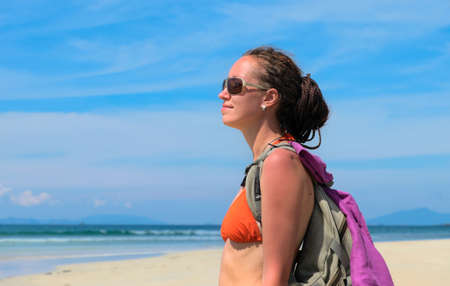 Young woman in sunglasses on the beach Stock Photo - 68537924