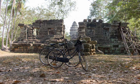 angor: Two bikes on the background of the ruins at Angor Wat in Cambodia