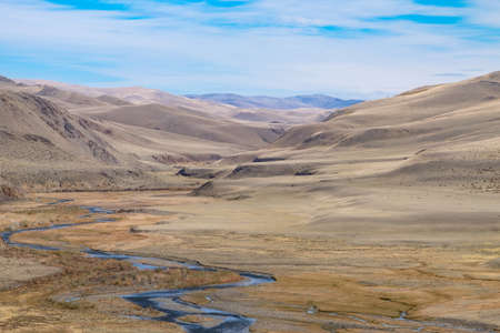 sedimentation: Fluvial terrace in Central Asia in the Altai. The result of glacial and river erosion. Photo illustrates well the geological processes Stock Photo