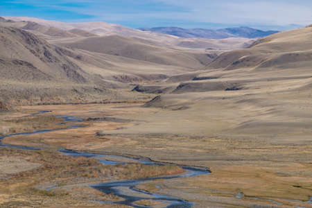 fluvial: Fluvial terrace in Central Asia in the Altai. The result of glacial and river erosion. Photo illustrates well the geological processes Stock Photo