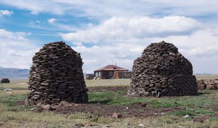 sheepfold: Pyramid from manure is a traditional way to procure fuel for the winter