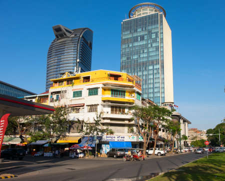 penh: PHNOM PENH, CAMBODIA - JANUARY 13, 2015:  Modern building of glass and concrete in the center of the capital of Cambodia, Phnom Penh