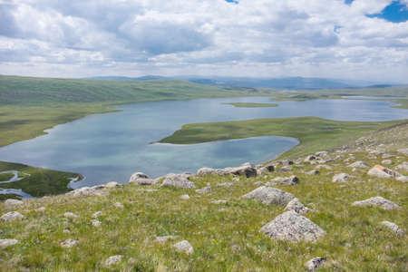 Mountain Lake in periglacial moraine Stock Photo