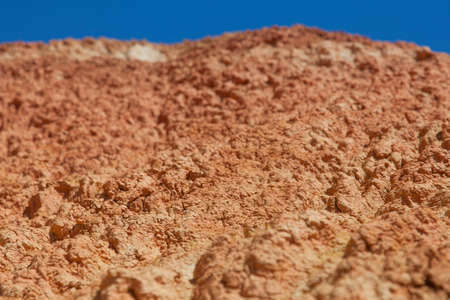 Red earth and blue sky in a wonderful location on the border of Altai and Mongolia Stock Photo