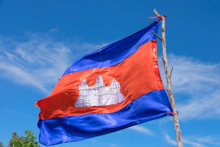 The flag of Cambodia is made in an artisan fashion. On the background of blue sky Stock Photo