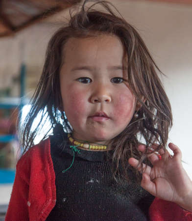Mongolian girl is very serious-looking, the daughter of a nomad