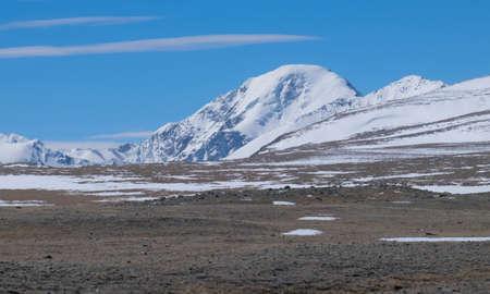 icefall: Dzhaniiktu sacred peak in the Altai Mountains in Central Asia