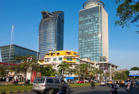 PHNOM PENH, CAMBODIA - JANUARY 13, 2015:  Modern building of glass and concrete in the center of the capital of Cambodia, Phnom Penh