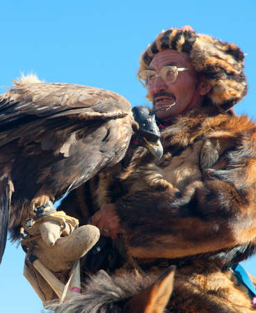 OLGIY, MONGOLIA - OCTOBER 2011;  Festival of falconry in North West Mongolia. Kazakh national sport Editorial