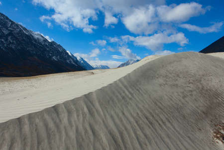 Dunes in the hills on the site of a mountain river Standard-Bild