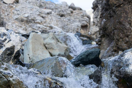 small stream in the mountains on the rocks