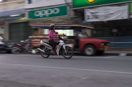 RANONG, THAILAND - JANUARY 2015: On the streets of the Thai town of Ranong is the easiest way to move around on the bike. Editorial