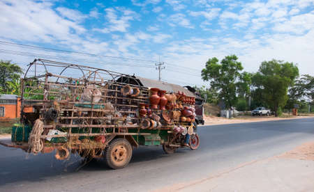 SIAM REAP, CAMBODIA - JANUARY 2015: Mobile shop for the sale of ceramic products in Cambodia, January 2015 Editorial