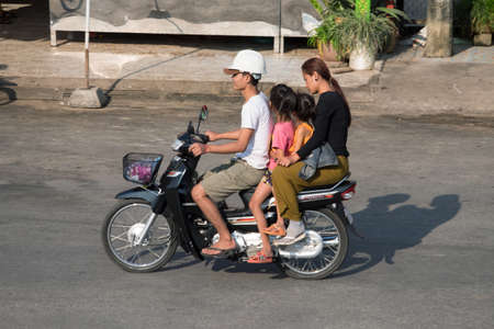 PHNOM PENH, CAMBODIA - JANUARY 2015: On the streets Cambodian stolicy easier to move around on the bike.