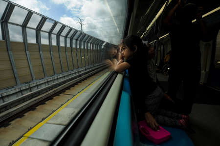 insider: Kuala Lumpur December 20, 2016. A girl enjoys the view from insider Mass Rapid Transit (MRT) train during the opening to the public of the MRT line at Sungai Buloh.