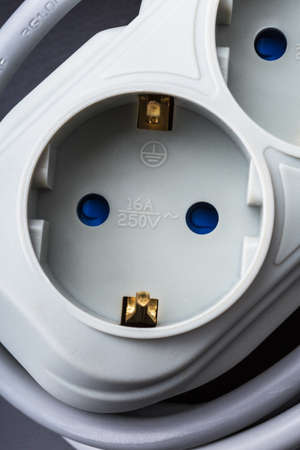surge: surge protector, electric outlet on a dark background