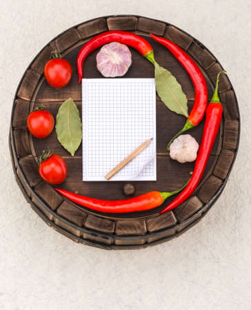 Notebook with recipes and shopping list in the kitchen photo