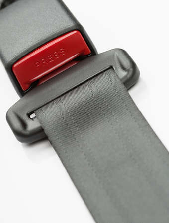 drive safely: Fastened seat belt. on white background.