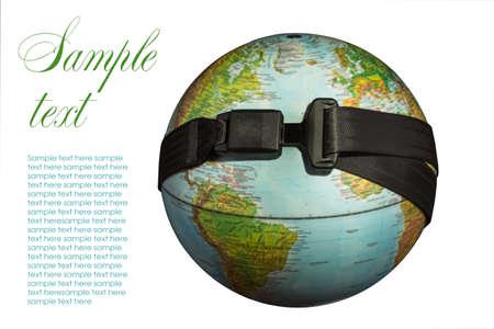 Globe with a seat belt on a dark background photo