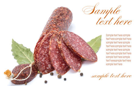 smoked sausage product with spices, isolated on a white background photo