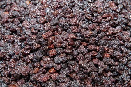 apricot kernels: Raisins, dried grapes, vertical background Stock Photo