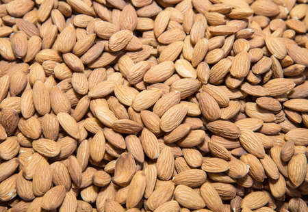 apricot kernels: a nutty background, lot out on the counter market of
