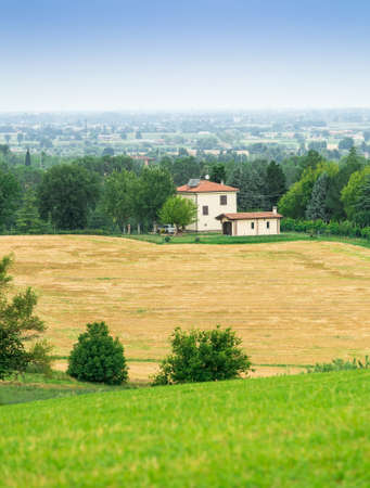 tuscany landscape: rural landscape with houses standing alone in the province of Tuscany in Italy