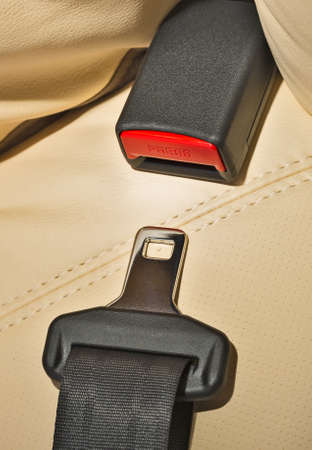seat belt: seat belt on a beige leather seat Stock Photo
