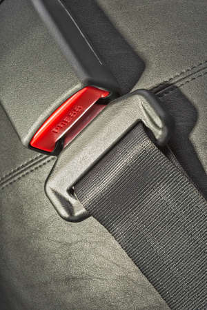 drive safely: seat belt on black leather seat