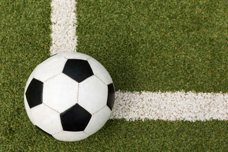 lay out: soccer ball on a soccer field Stock Photo