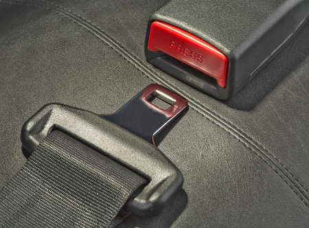 seat belt: seat belt on black leather seat