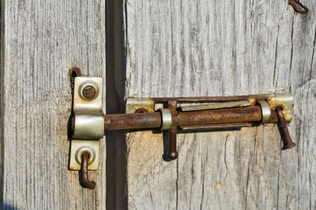 deadbolt: old deadbolt on wooden door