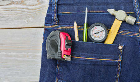 trouser: Small tools in the pocket of trouser Stock Photo
