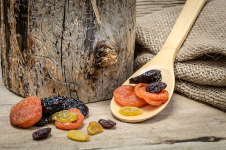 trimming: Still life with dried fruits and wooden trimming Stock Photo