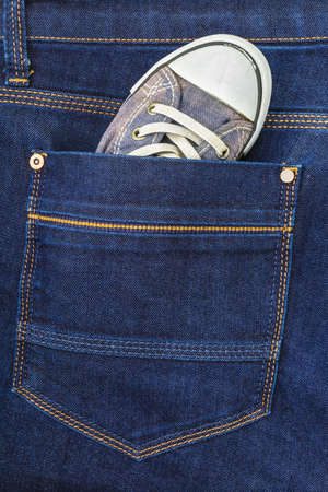 gym shoes: Gym shoes in the pocket of trouser