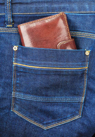 trouser: Brown wallet in the pocket of trouser