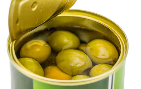 tinned goods: Opened tin with green olives isolated on white