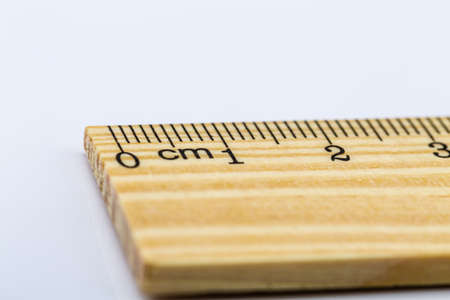 empirical: Wooden rulers over a white background Stock Photo