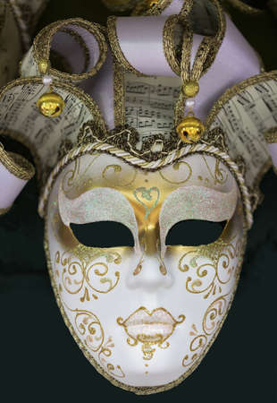 clandestine: VENICE, ITALY - JUNE 26, 2014: Masks were worn in Venice to disguise the wearer from illicit activities: gambling, dancing, clandestine affairs or even political assignation. Stock Photo